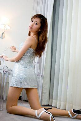 hot asian woman in light dress