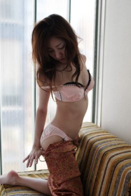 cute asian girl taking clothes off